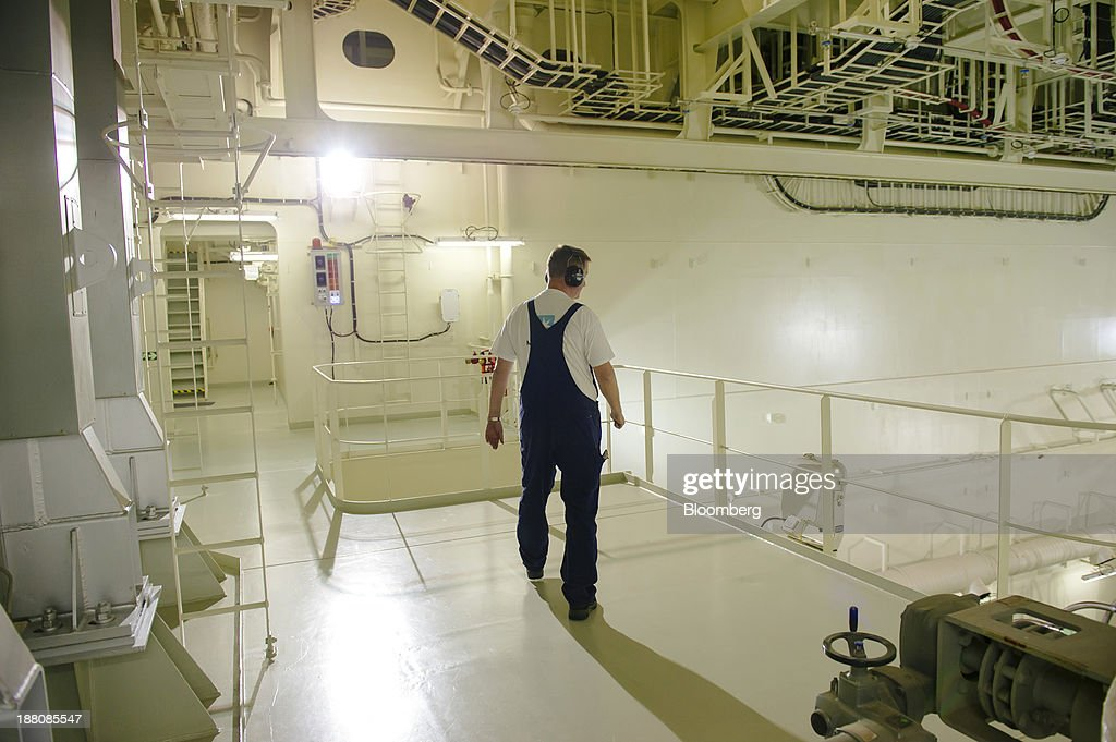 An engineer wears ear protectors as he observes the operation of one of the ship's two engines aboard the Maersk Mc-Kinney Moeller Triple-E Class container ship, operated by A.P. Moeller-Maersk A/S, as it sails between Rotterdam in the Netherlands and Bremerhaven, Germany, on Monday, Nov. 11, 2013. A.P. Moeller-Maersk A/S's container-shipping line, the world's largest, reported an 11 percent increase in third-quarter profit after cost cuts countered a decline in freight rates. Photographer: Kristian Helgesen/Bloomberg via Getty Images