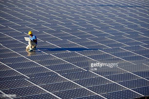 An engineer working at a photovoltaic farm