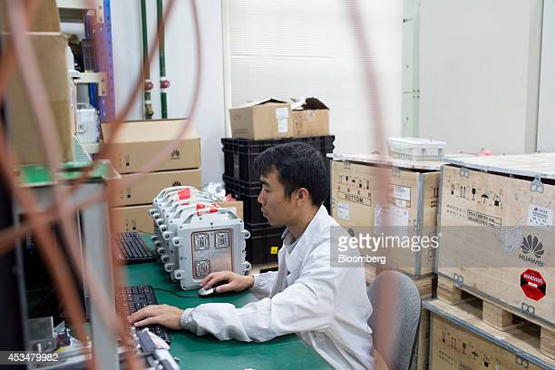 An engineer works at a computer inside the global compliance and testing center at the Huawei Technologies Co campus in the Longgang district of...
