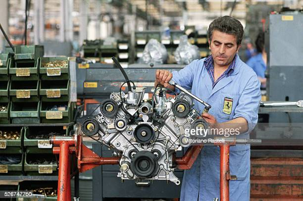 An engineer works on a Ferrari engine at the factory in Maranello Italy