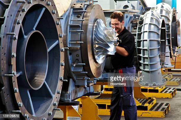 An engineer works on the assembly of turbocharging units at the ABB Turbo Systems plant operated by ABB AG in Baden Switzerland on Tuesday Aug 30...
