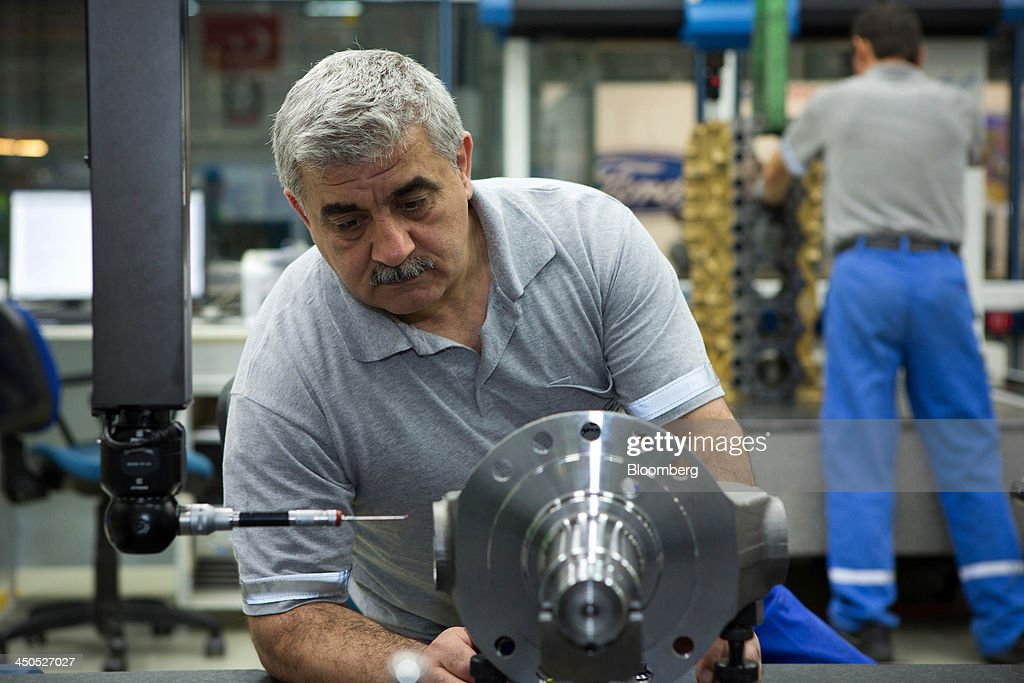 An engineer works on the machining of an automotive part in the production plant for Ford Cargo trucks at Ford Otosan, the joint venture between Ford Motor Co.'s Ford Otomotiv Sanayi AS and Koc Holding AS, in Eskisehir, Turkey, on Monday, Nov. 18, 2014. Ford Otomotiv Sanayi AS chief executive officer Haydar Yenigun said in September Turkey is about to 'lose the diamond' which is light commercial vehicle production due to government policies such as tax hikes, ban on their lease, Dunya newspaper says. Photographer: Kerem Uzel/Bloomberg via Getty Images