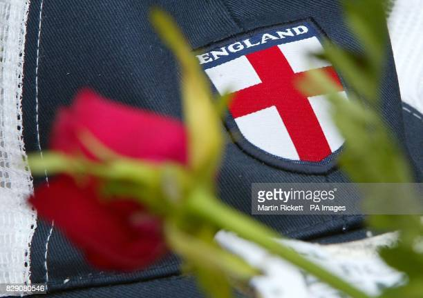 An England cap and red rose pictured at a shrine in Rossio Square Lisbon for Stephen Smith from Wolverhampton who was stabbed during celebrations...
