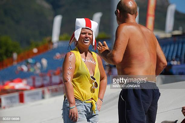 An England cricket fan smiles as she displayes slogans in honour of recordbreaking England batsman Jimmy Stokes sprayed on her body while looking on...
