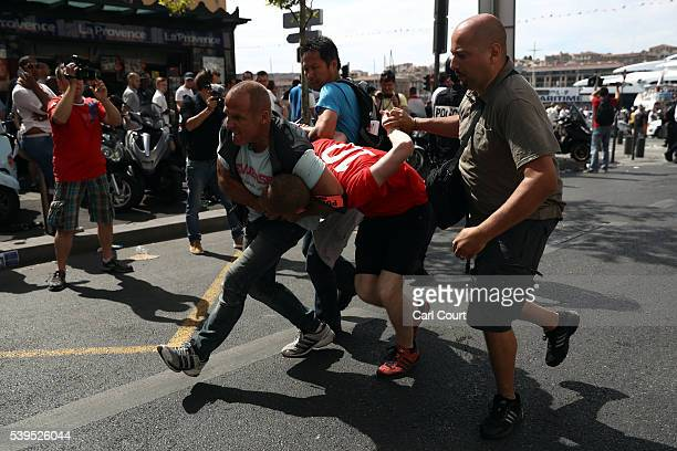 An England fan is arrested after clashing with police ahead of the game against Russia later today on June 11 2016 in Marseille France Football fans...