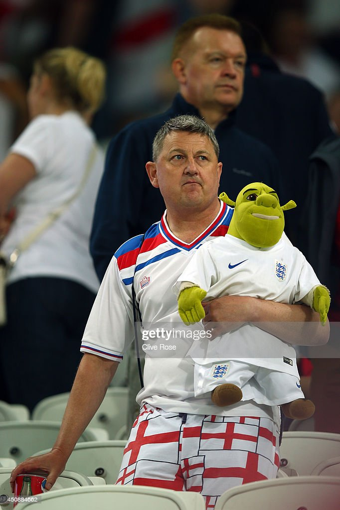 An England fan looks dejected after the team's 2-1 defeat in the 2014 FIFA World Cup Brazil Group D match between Uruguay and England at Arena de Sao Paulo on June 19, 2014 in Sao Paulo, Brazil.