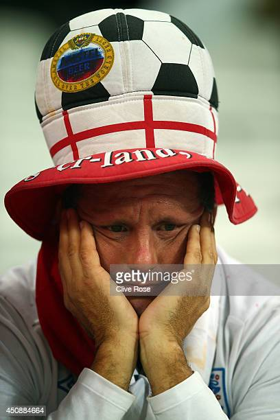 An England fan looks dejected after the team's 21 defeat in the 2014 FIFA World Cup Brazil Group D match between Uruguay and England at Arena de Sao...