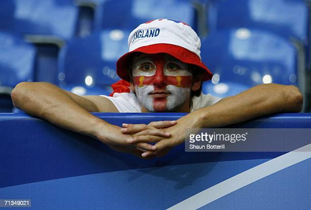 An England fan looks on dejectedly following his team's defeat in a penalty shootout at the end of the FIFA World Cup Germany 2006 Quarterfinal match...