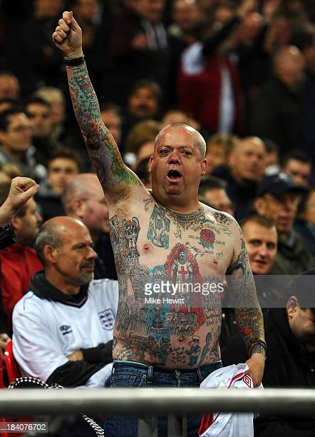 An England fan shows off his tattoos during the FIFA 2014 World Cup Qualifying Group H match between England and Montenegro at Wembley Stadium on...
