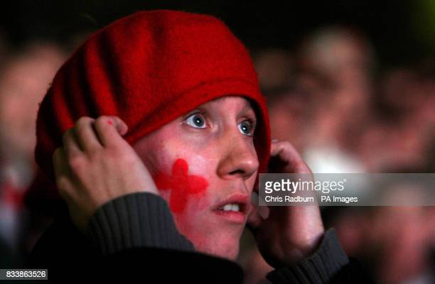 An England fan watches the Rugby World Cup Final Match on an outdoor big screen near the Eiffel Tower in Paris
