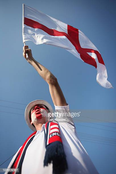 An England fan waves a flag outside the Royal Bafokeng Stadium on June 12 2010 in Rustenburg South Africa England play the USA tonight at the Royal...