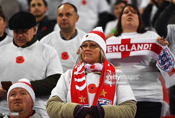 An England fan wears a Poppy tshirt prior to the FIFA 2018 World Cup qualifying match between England and Scotland at Wembley Stadium on November 11...