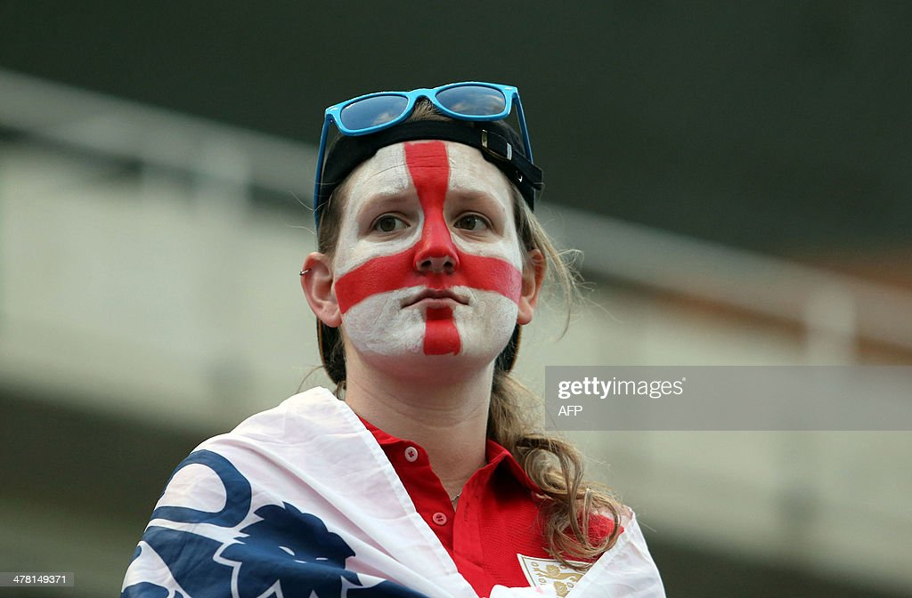 An England fan with her face painted in the colours of her national flag watches her team play during their Cyprus Women's Cup final football match against France at the Neo GSP stadium in Nicosia on March 12, 2014.