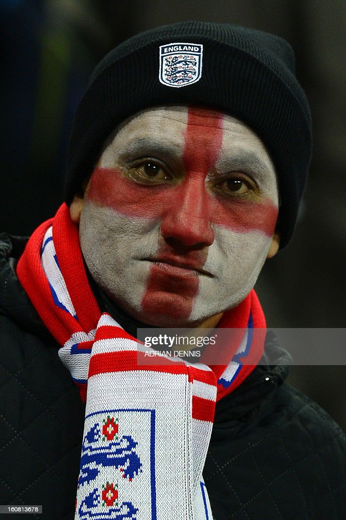 An England fan with his face painted with the cross of St George waits for the start of the international friendly football match between England and Brazil at Wembley Stadium in north London on February 6, 2013.