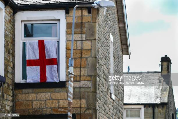 An England flag hangs from a house window outside Turf Moor the home stadium of Burnley prior to the Premier League match between Burnley and...