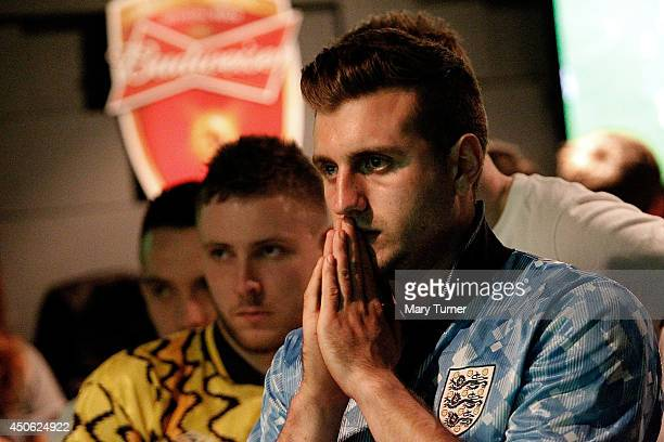 An England football fan prays as he watches England try to beat Italy in their opening match of the 2014 FIFA World Cup on June 14 2014 in London...