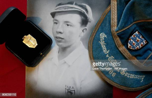 An England schoolboys photograph of England World Cup winner Nobby Stiles alongside his 1966 World Cup winners medal and cap during a photocall at...