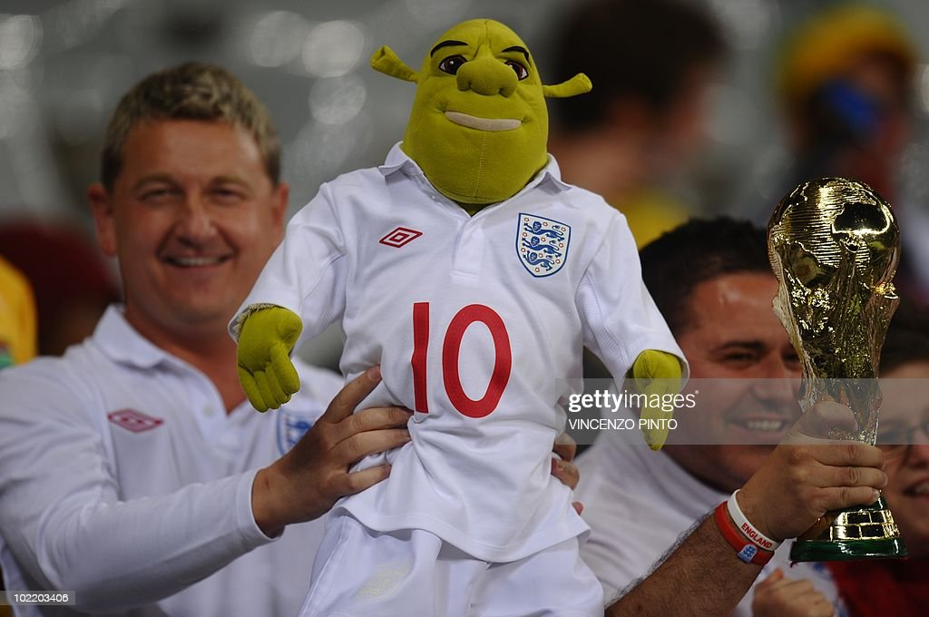An England supporter holds a Shrek stuffed toy prior to the start of the Group C first round 2010 World Cup football match England vs. Algeria on June 18, 2010 at Green Point stadium in Cape Town. NO