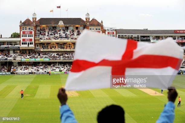 An England supporter in the stand waving a flag during the game against Sri Lanka