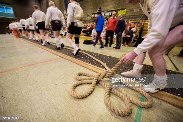 An England team member picks up the rope as they prepare to compete during the 600 and 680 kilo international categories during the UK indoor Tug of...
