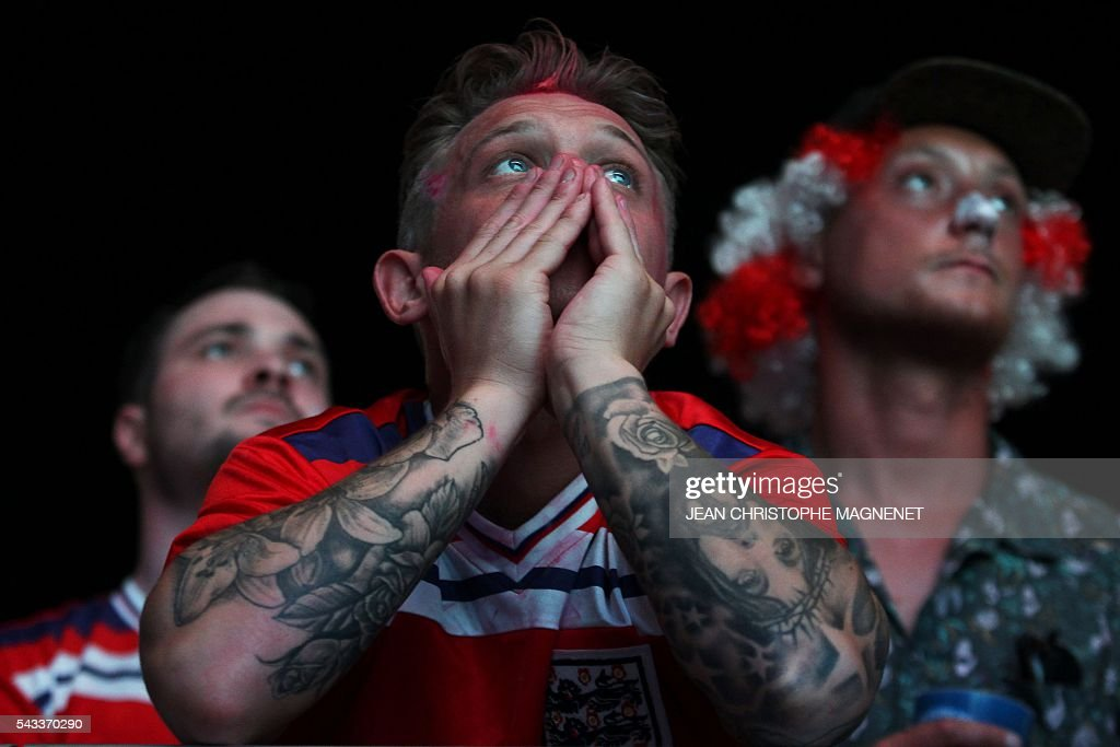 An England's fan is disappointed after the football match between Iceland and England at the Champ-de-Mars fan zone in Paris on June, 27, 2016. / AFP / JEAN