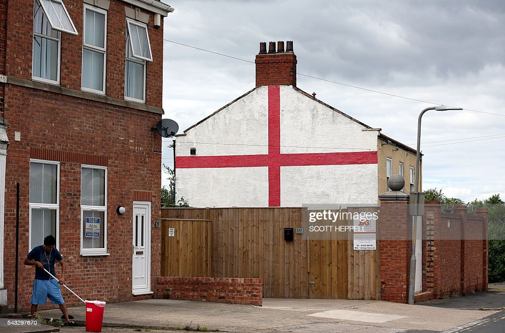 An English Cross of St George flag is seen painted on the side of the property in Stockton On Tees, north east England on June 27, 2016 Britain's historic decision to leave the 28-nation bloc has sent shockwaves through the political and economic fabric of the nation. It has also fuelled fears of a break-up of the United Kingdom with Scotland eyeing a new independence poll, and created turmoil in the opposition Labour party where leader Jeremy Corbyn is battling an all-out revolt. / AFP / Scott Heppell