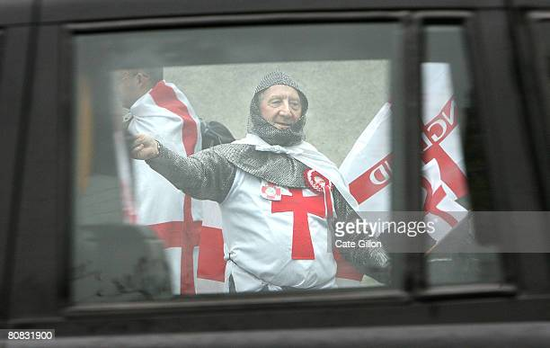 An English Democrat Party supporter dressed as Saint George waves to passing cars on April 23 2008 in London England The English Democrat Party who...