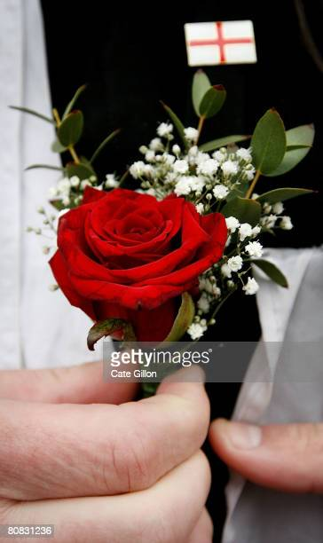 An English Democrat Party supporter pins a rose on his collar on April 23 2008 in London England The English Democrat Party are campaigning for Saint...