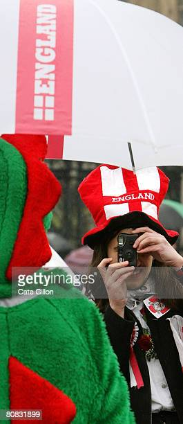 An English Democrat Party supporter takes a photo of another supporter dressed as a dragon on April 23 2008 in London England The English Democrat...