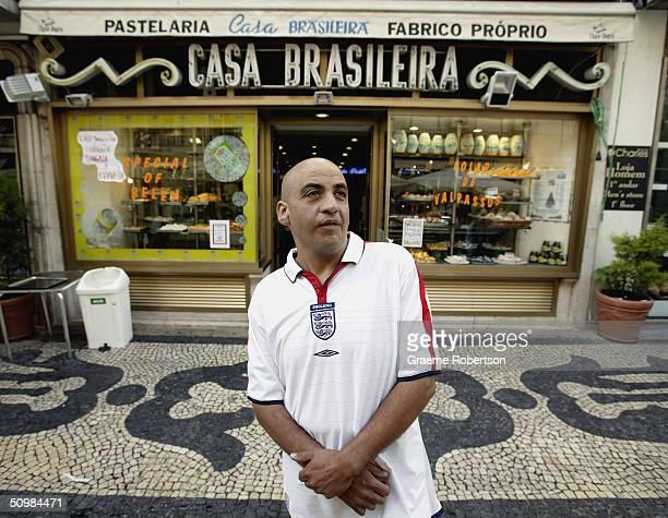 An English fan stands outside the bakery where an English fan was stabbed last night June 21 on June 22 2004 on Rua Augusta Steet Lisbon Portugal A...