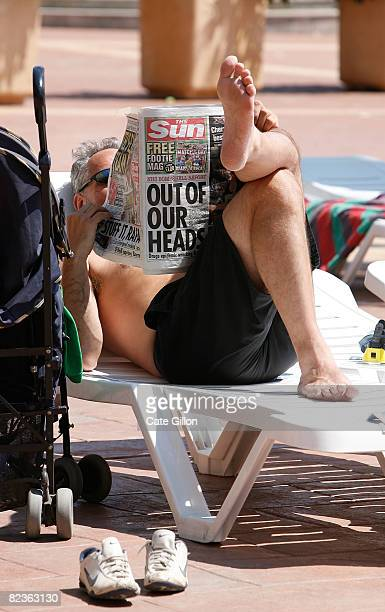 An English holidaymaker reads The Sun at the poolside of the Costa Entantada Hotel on August 15 2008 in Lloret de Mar Spain The Costa Entantada...