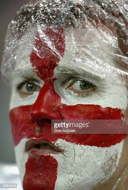 An English supporter in the rain during the Rugby World Cup Pool C match between England and Georgia at Subiaco Oval October 12 2003 in Perth...