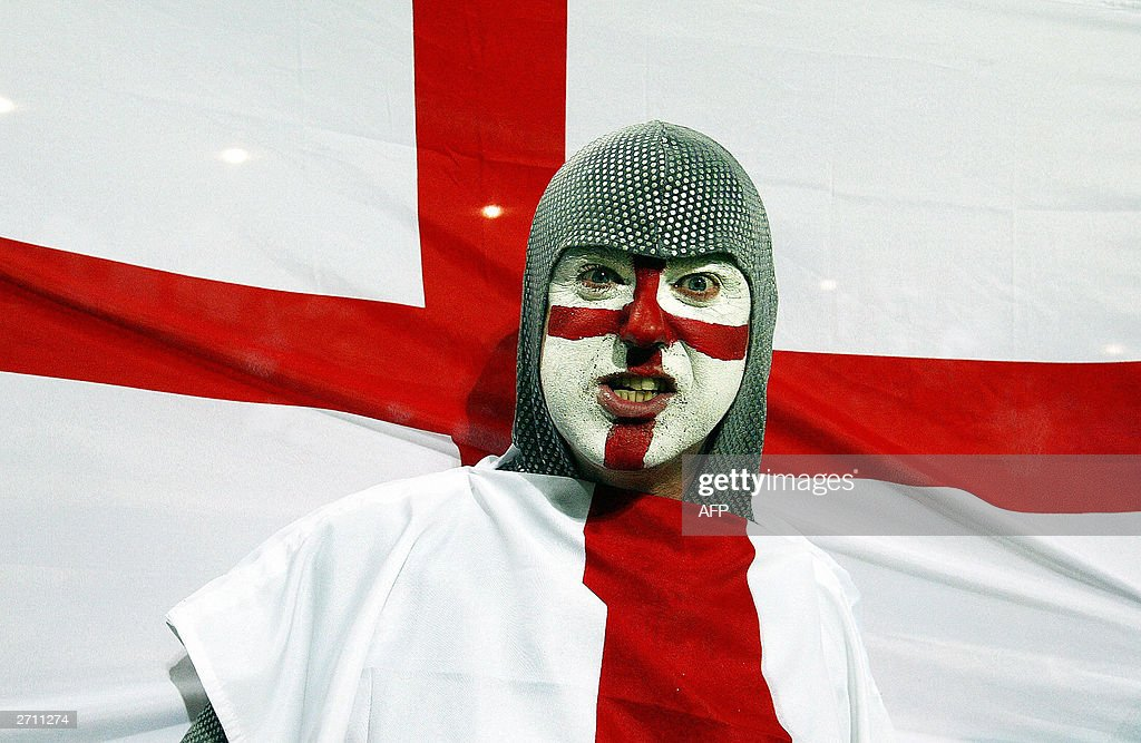 An English supporter wearing a chainmail and waving the flag of St George arrives for the quarterfinal Rugby World Cup 2003 match between England and...