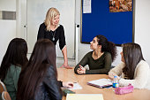 An English teacher talks to students in her class at the American University of Iraq Sulaimani