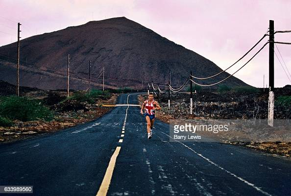 An Englishman with a Union Jack Tshirt running some of the 35miles of road 27th May 1997 on Ascension a small isolated volcanic island in the...