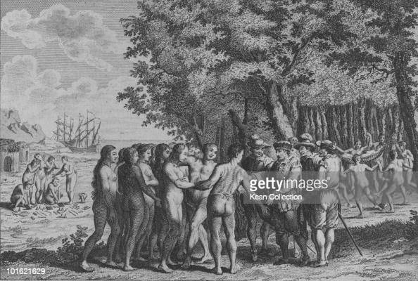 An engraved portrait of Spanish conquistador Hernando Cortez at his first landing in the Yucatan Mexico Native American girls are presented to Cortez...
