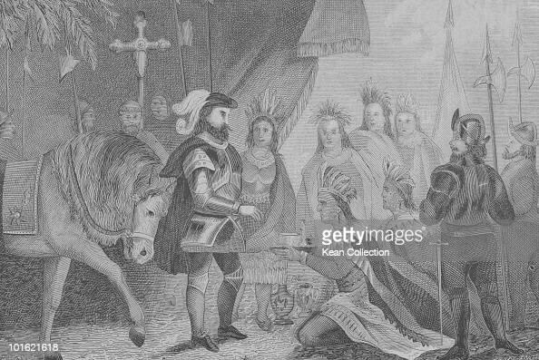 An engraved portrait of Spanish conquistador Hernando Cortez receiving Montezuma's presents circa 1518