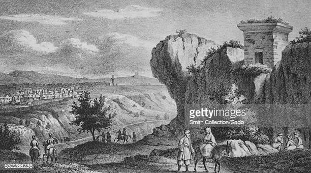 An engraving showing a Palestinian landscape a woman is riding on the back of a donkey while a man walks beside her other men are shown riding...