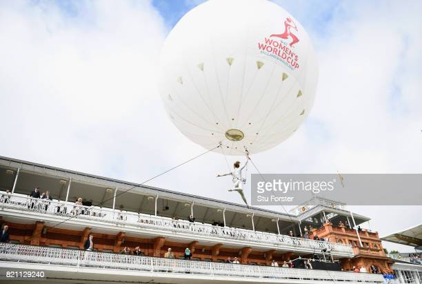 An entertainer flys above the players balcony before the ICC Women's World Cup 2017 Final between England and India at Lord's Cricket Ground on July...