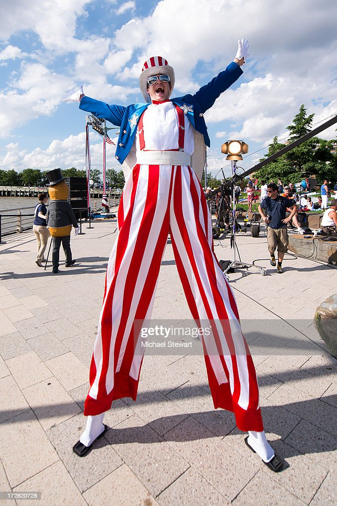 An entertainer on stilts attends the 37th annual Macy's 4th of July Fireworks over the Hudson River on July 4, 2013 in New York City.