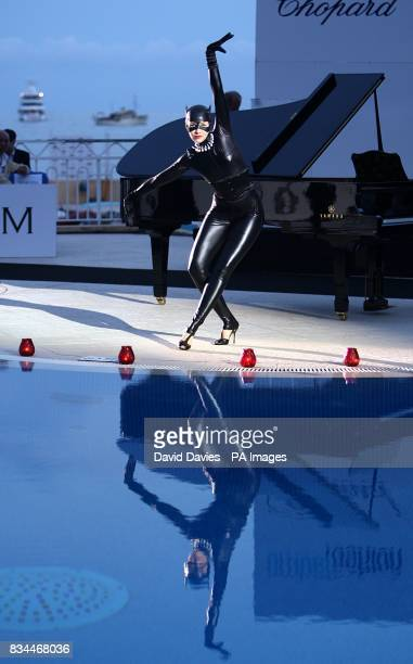 An entertainer performs at the Grand Prix and Fashion Unite at The Amber Lounge Le Meridien Beach Plaza Hotel Monaco