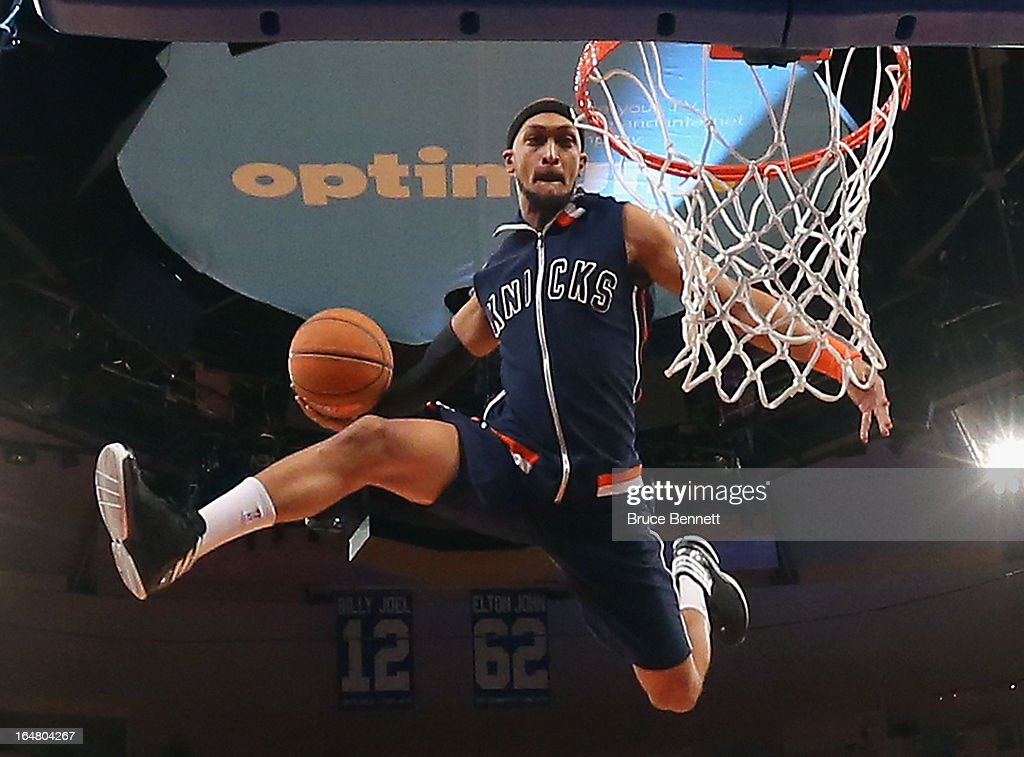 An entertainer works halftime during the game between the New York Knicks and the Memphis Grizzlies at Madison Square Garden on March 27, 2013 in New York City. The Knicks defeated the Grizzlies 108-101.