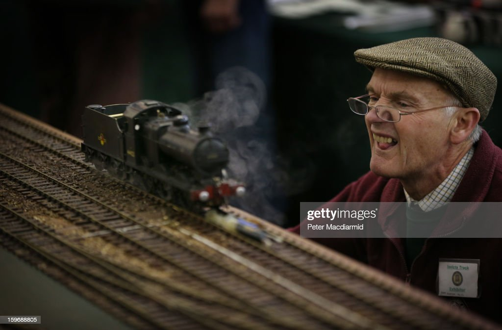 An enthusiast checks a locomotive at The London Model Engineering Exhibition at Alexandra Palace on January 18, 2013 in London, England. The exhibition features more than a thousand models from over 50 national and regional clubs and societies. A wide range of locomotives, boats and aircraft are on show.