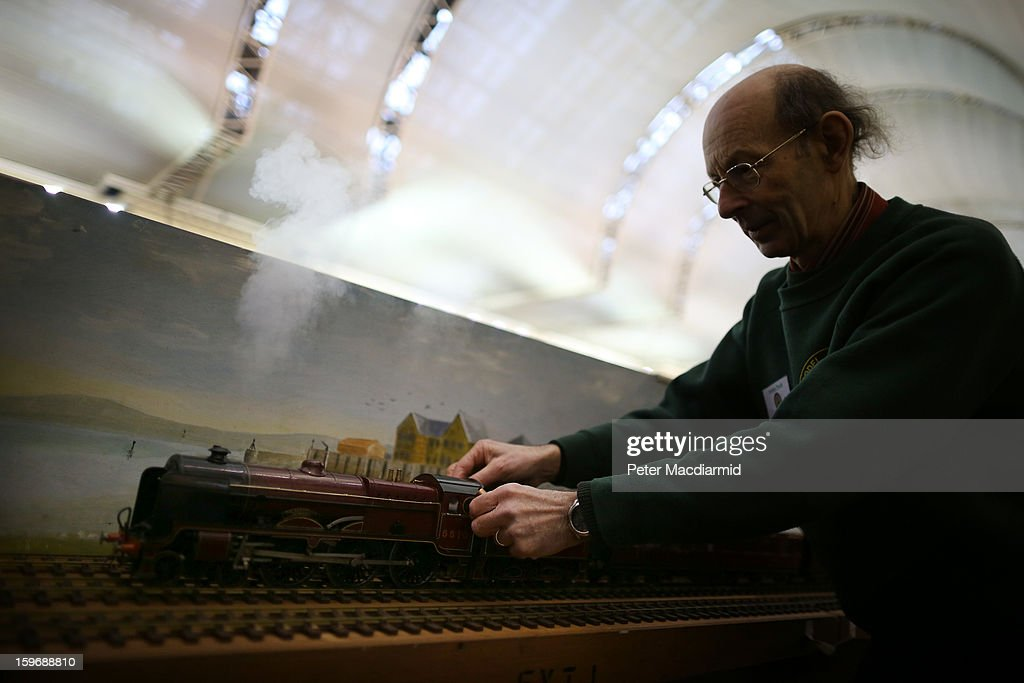 An enthusiast checks the steam pressure on a locomotive at The London Model Engineering Exhibition at Alexandra Palace on January 18, 2013 in London, England. The exhibition features more than a thousand models from over 50 national and regional clubs and societies. A wide range of locomotives, boats and aircraft are on show.