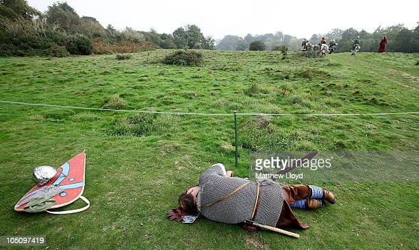 An enthusiast dressed as a soldier takes a break during a reenactment of the 1066 AD Battle of Hastings on October 9 2010 in Battle near Hastings in...