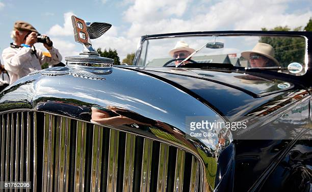 An enthusiast takes a photo of competitors waiting to take an old Bentley to the hill tests at the Brooklands Motoring Festival 2008 'The Double...