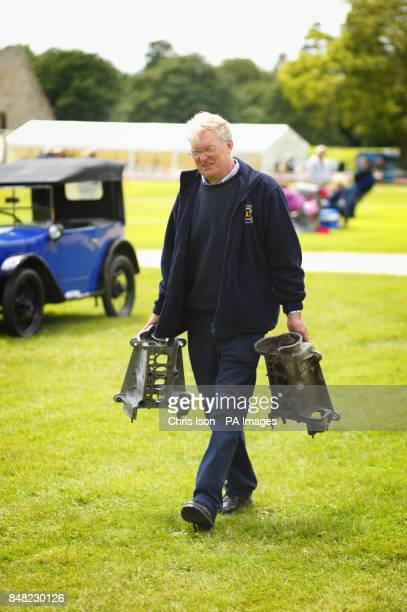 An enthusiast takes home some purchases from the auto jumble at the 50th Austin Seven rally at the National Motor Museum in Beaulieu Hampshire