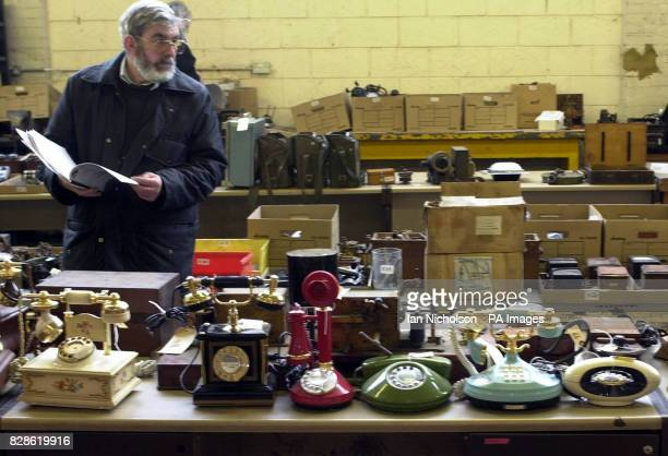 An enthusiast views a selection of 1980's telephone handsets which form part of a lot in an auction of memorabilia by BT's Connected Earth national...