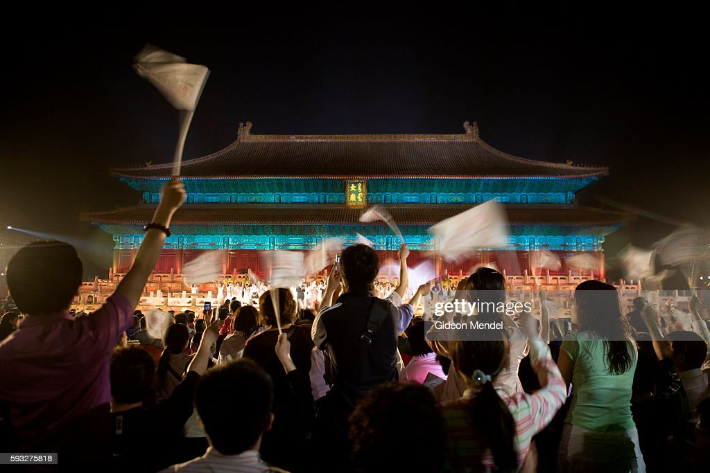 An enthusiastic audience responds to the group finale which included nearly 100 singers and dancers at the Tai Miao Ancestral Temple in the Forbidden...
