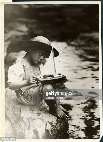 An enthusiastic sailorman putting the finishing touches on his yacht before tempting the swift waters of Gwynn Falls Creek Marland